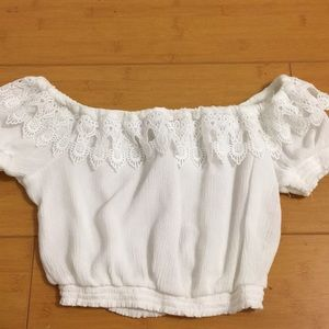 Cute white size small lace crop top never used.